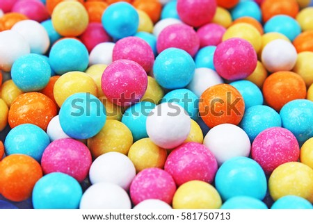 Bubble gum chewing gum texture. Rainbow multicolored gumballs chewing gums as background. Round sugar coated candy bonbon bubblegum texture. Colorful multicolor bubblegums wallpaper. Candy background #581750713
