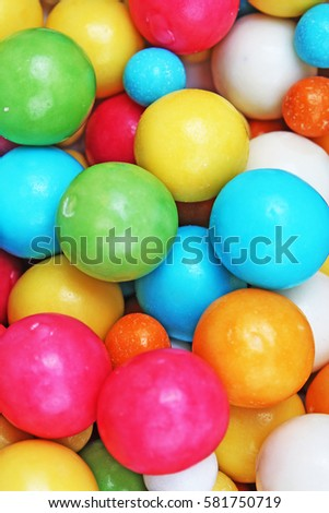 Bubble gum chewing gum texture. Rainbow multicolored gumballs chewing gums as background. Round sugar coated candy bonbon bubblegum texture. Colorful multicolor bubblegums wallpaper. Candy background #581750719