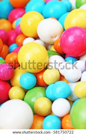 Bubble gum chewing gum texture. Rainbow multicolored gumballs chewing gums as background. Round sugar coated candy bonbon bubblegum texture. Colorful multicolor bubblegums wallpaper. Candy background #581750722