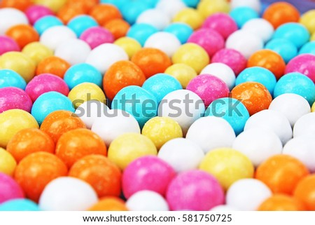 Bubble gum chewing gum texture. Rainbow multicolored gumballs chewing gums as background. Round sugar coated candy bonbon bubblegum texture. Colorful multicolor bubblegums wallpaper. Candy background #581750725