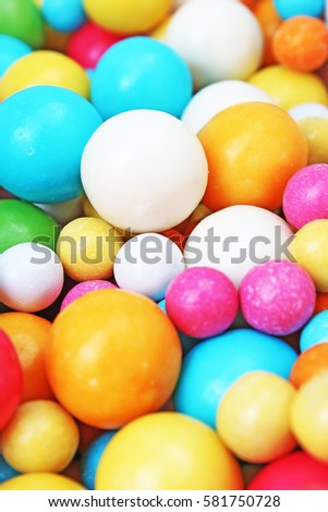Bubble gum chewing gum texture. Rainbow multicolored gumballs chewing gums as background. Round sugar coated candy bonbon bubblegum texture. Colorful multicolor bubblegums wallpaper. Candy background #581750728