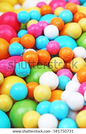 Bubble gum chewing gum texture. Rainbow multicolored gumballs chewing gums as background. Round sugar coated candy bonbon bubblegum texture. Colorful multicolor bubblegums wallpaper. Candy background #581750731