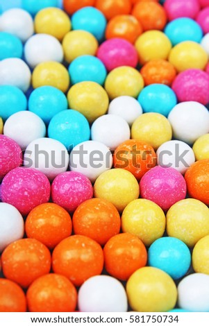 Bubble gum chewing gum texture. Rainbow multicolored gumballs chewing gums as background. Round sugar coated candy bonbon bubblegum texture. Colorful multicolor bubblegums wallpaper. Candy background #581750734