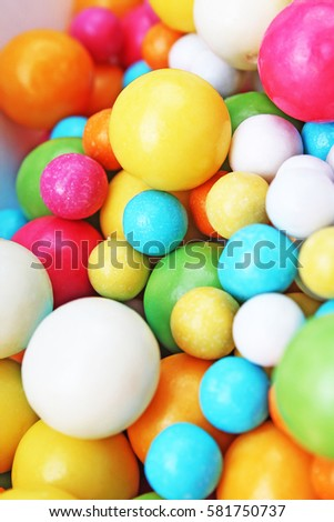 Bubble gum chewing gum texture. Rainbow multicolored gumballs chewing gums as background. Round sugar coated candy bonbon bubblegum texture. Colorful multicolor bubblegums wallpaper. Candy background #581750737