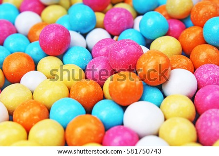 Bubble gum chewing gum texture. Rainbow multicolored gumballs chewing gums as background. Round sugar coated candy bonbon bubblegum texture. Colorful multicolor bubblegums wallpaper. Candy background #581750743