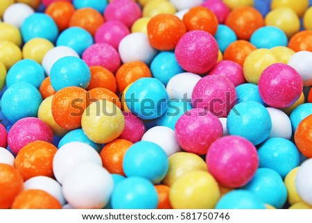 Bubble gum chewing gum texture. Rainbow multicolored gumballs chewing gums as background. Round sugar coated candy bonbon bubblegum texture. Colorful multicolor bubblegums wallpaper. Candy background #581750746