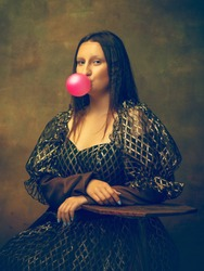 Bubble gum. Young woman as Mona Lisa, La Gioconda isolated on dark green background. Retro style, comparison of eras concept. Beautiful female model like classic historical character, old-fashioned.
