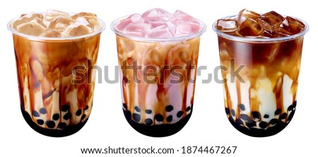 Bubble Milk Tea - A plastic glass of fresh milk with black sugar syrup (Kuromitsu) and hot black pearl (Boba) on White Background, Taiwanese drinking culture