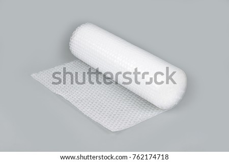 Bubble wrap in a roll on a gray background #762174718