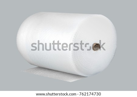 Bubble wrap in a roll on a gray background