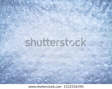 Bubble wrap. Plastic packaging material. Close-up photo. Free antistress. Abstract light, white background  #1522336340