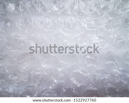 Bubble wrap. Plastic packaging material. Close-up photo. Free antistress. Abstract light, white background  #1522927760