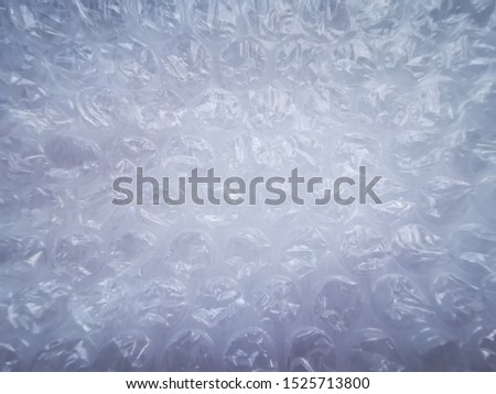 Bubble wrap. Plastic packaging material. Close-up photo. Free antistress. Abstract light, white background  #1525713800