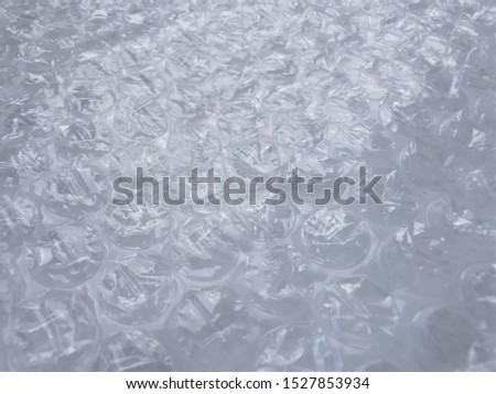 Bubble wrap. Plastic packaging material. Close-up photo. Free antistress. Abstract light, white background  #1527853934