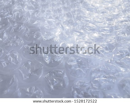 Bubble wrap. Plastic packaging material. Close-up photo. Free antistress. Abstract light, white background  #1528172522
