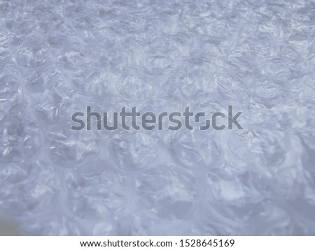 Bubble wrap. Plastic packaging material. Close-up photo. Free antistress. Abstract light, white background  #1528645169