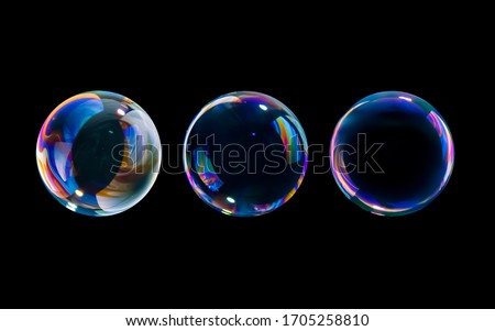 Photo of  BUBBLES ISOLATED ON BLACK BACKGROUND