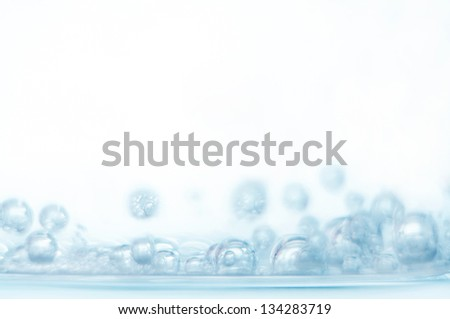 Bubbles of oxygen in glass of water on a white background. Mineral water. Water enriched with oxygen.Oxygen. Water.Water background. Macro.Texture.Glass with water.Natural.