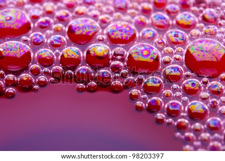 Bubbles of red wine from the different foreshortening  in glass