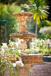 Bubbling fountain in courtyard garden - portrait exterior