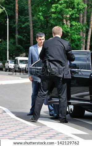 BUCHA, UKRAINE - 31 MAY 2013: The unknown bodyguards meet the VIP person on May 31, 2013 in Bucha, Ukraine.