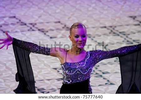 BUCHAREST - APRIL 17: Unknown latin dancers, compete at IDSF (International Dance Sport Federation) Dance Masters on April 17, 2011 in Bucharest, Romania
