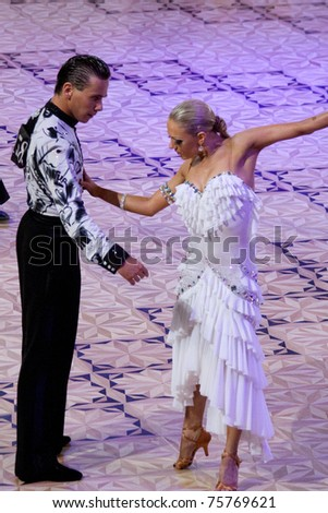 BUCHAREST - APRIL 17: Unknown latin dancers, competing at IDSF (International DanceSport Federation) Dance Masters on April 17, 2011 in Bucharest, Romania