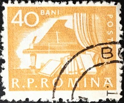 Bucharest, circa 1960: used Romanian stamp from the daily life series, Piano and Books.