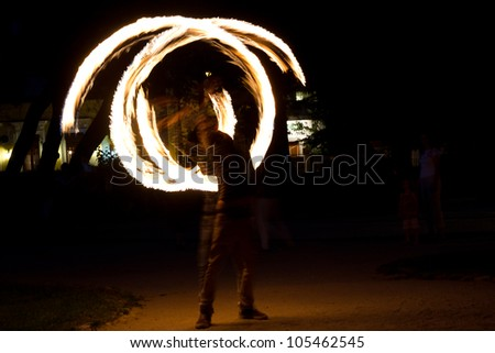 BUCHAREST - JUNE 16: Fire jugglers perform in 'Gradina Icoanei' Park during Street Delivery 2012, on June 16, 2012 in Bucharest, Romania