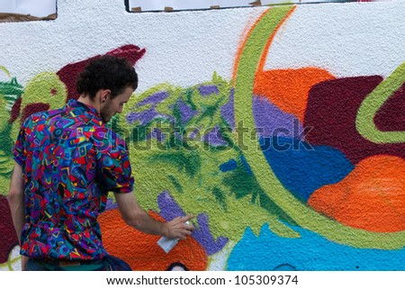 BUCHAREST - JUNE 15: Unknown artists paint graffiti on Arthur Verona - Painter street, as part of the Street Delivery 2012, on June 15, 2012 in Bucharest, Romania