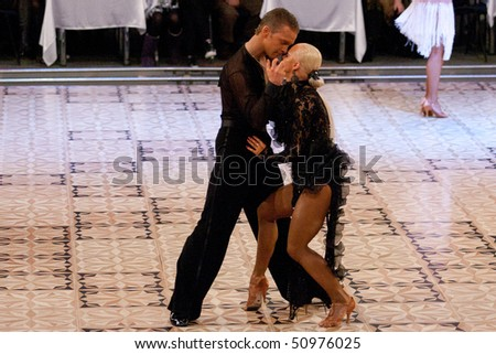 BUCHAREST - MARCH 14: Dance couple at IDSF Dance Masters on March 14, 2010 in Bucharest, Romania.