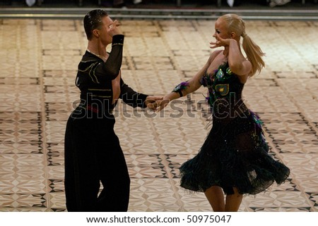 BUCHAREST - MARCH 14: Unidentified dance couple at IDSF Dance Masters on March 14, 2010 in Bucharest, Romania.