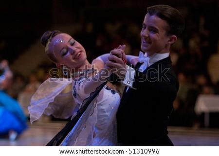 BUCHAREST - MARCH 14: Vlad Pislariu - Eszter Pop, ROMANIA, dance couple at IDSF Dance Masters on March 14, 2010 in Bucharest, Romania