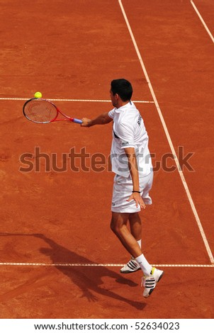BUCHAREST, ROMAINIA  MAY 8:  Romania's Victor Hanescu performs a backhand during the Davis Cup doubles meeting between Romania and Ukraine - BNR Arenas on May 8, 2010 in Bucharest, Romania.