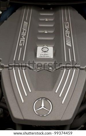 "BUCHAREST, ROMANIA - APRIL 05: Car exhibition at Bucharest ""BUCHAREST SIAB 2012"", Mercedes-Benz SLS AMG engine details. April 05, 2012, Bucharest, Romania. - stock photo"