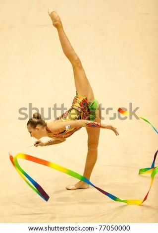 BUCHAREST, ROMANIA - APRIL 3: Daria Kondakova performs during the Irina Deleanu Orange Trophy on April 3, 2011, Bucharest, Romania - stock photo