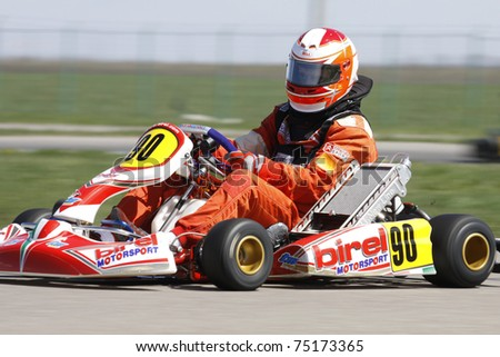 BUCHAREST, ROMANIA - APRIL 9: Parvu Nicolae competes in National Karting Championship on April 9, 2011 in Bucharest, Romania.