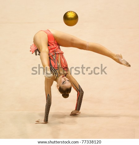 BUCHAREST, ROMANIA - APRIL 3: Unknown gymnast performs during the Irina Deleanu Orange Trophy on April 3, 2011, Bucharest, Romania