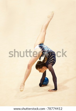 BUCHAREST, ROMANIA - APRIL 3: Unknown gymnast performs during the Irina Deleanu Orange Trophy on April 3, 2011, Bucharest, Romania