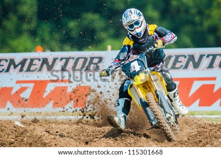 BUCHAREST, ROMANIA - AUGUST 25: An unidentified rider participates in the Fourth National Endurocross Championship on Aug 25, 2012 at Dragomiresti Deal in Bucharest, Romania - stock photo