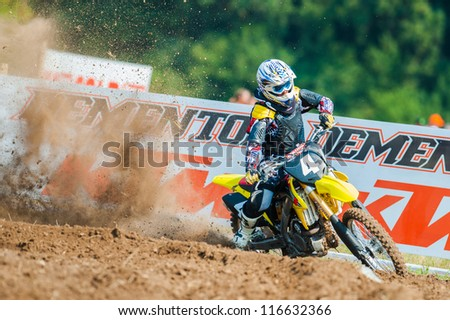 BUCHAREST, ROMANIA - AUGUST 25: An unidentified rider participates in the Fourth National Endurocross Championship on Aug 25, 2012 at Dragomiresti Deal in Bucharest, Romania