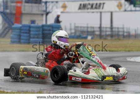 BUCHAREST, ROMANIA - AUGUST 20: Gabi Tomescu, number 5, competes in National Karting Championship, Round 5, on august 20, 2012 in Bucharest, Romania.
