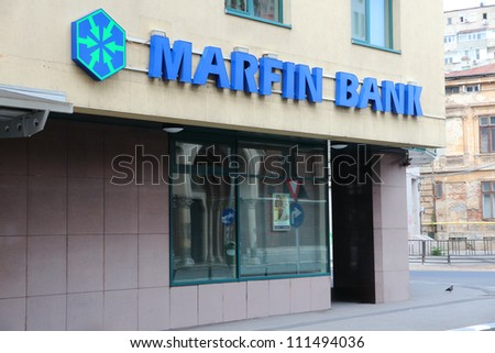 BUCHAREST, ROMANIA - AUGUST 19: Marfin Bank branch on August 19, 2012 in Bucharest, Romania. Marfin Group is one of largest companies in Greece. As of 2010 it employed 17,300 people.