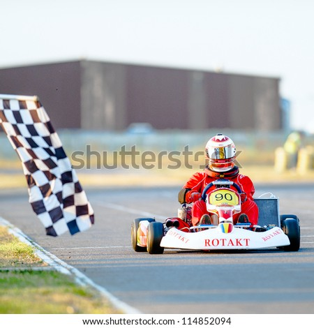 BUCHAREST, ROMANIA - AUGUST 4: Unknown pilot competing in National Karting Championship 2012 at Amkart Bucharest, on August 4, 2012 in Bucharest, Romania