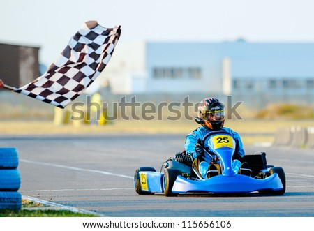 BUCHAREST, ROMANIA - AUGUST 4: Unknown pilot competing in National Karting Championship 2012 at Amkart Bucharest, on August 4, in Bucharest, Romania