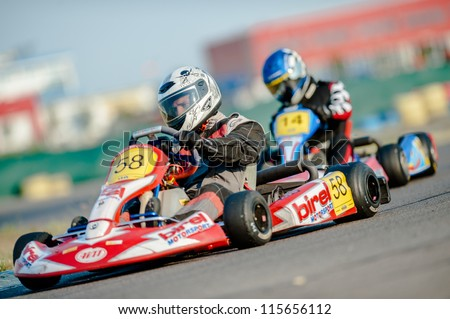 BUCHAREST ROMANIA AUGUST 4 Unknown pilots competing in National Karting Championship 2012 at Amkart Bucharest on August 4 in Bucharest Romania