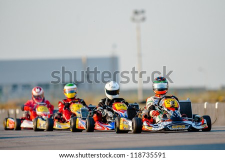 BUCHAREST, ROMANIA - AUGUST 4: Unknown pilots competing in National Karting Championship 2012 at Amkart Bucharest, on August 4, in Bucharest, Romania