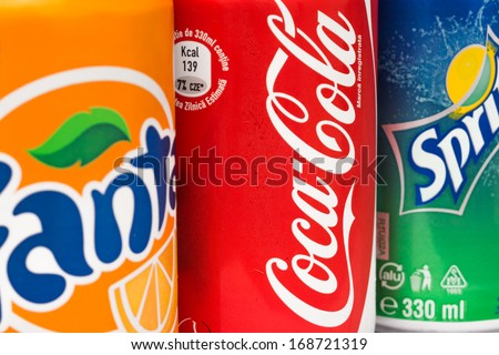 BUCHAREST, ROMANIA - DECEMBER 26, 2013: Coca-Cola, Fanta and Sprite Cans. The three drinks produced by the Coca-Cola Company are the worlds best sold refreshing drinks.