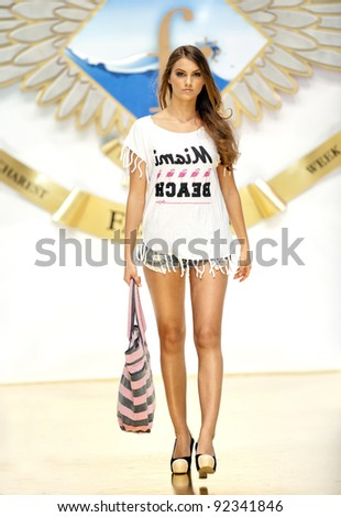 BUCHAREST, ROMANIA - DECEMBER 3: Fashion model wears clothes from BSB collection, in Bucharest Fashion Week at World Trade Center on December 3, 2011 in Bucharest, Romania