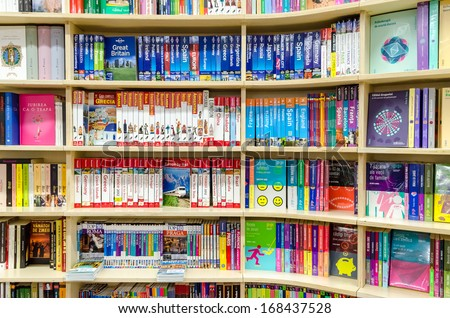 BUCHAREST, ROMANIA - DECEMBER 20, 2013: Travel books in library book stand. Travel literature includes works of exploration as well as guidebooks and accounts of visits to foreign countries.